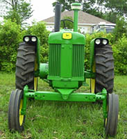 tractor with adjustable wide front end