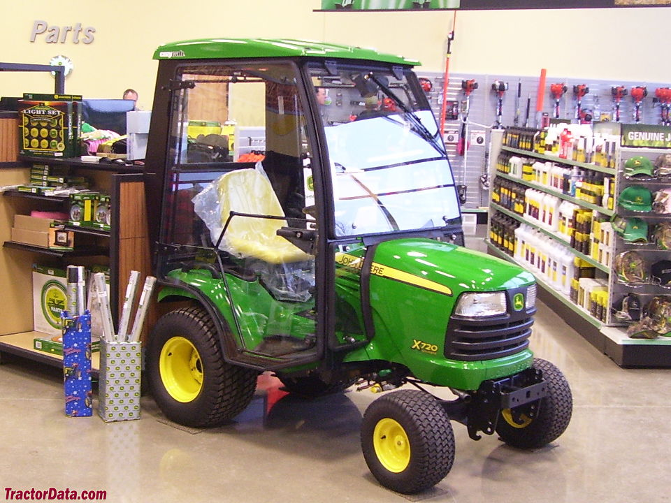 John Deere X720 with Cozy Cab built hard cab.