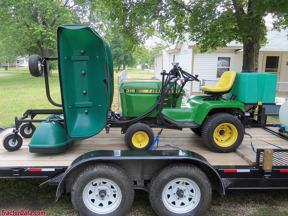 John Deere 316 with custom hydraulics and lawn sprayer.