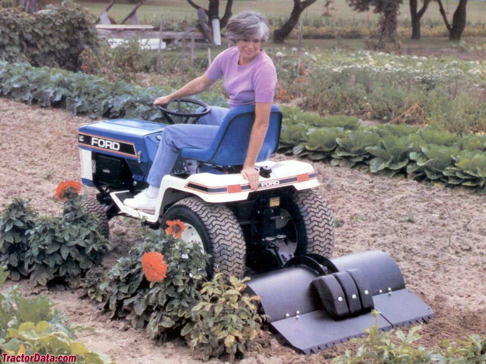 Delightful Ford LGT 18H Garden Tractor With Tiller.