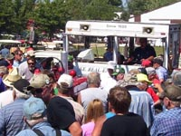 The crowd bids on a Farmall H restored by the local FFA.