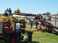 A threshing crew works in the August sun.
