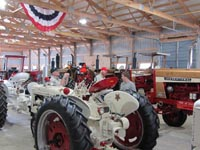 Gold and White Demonstrator tractors on display