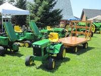 Deere 332, 112, 140 H1, 110, and John Deere 140 H3 with miniture hay wagon.