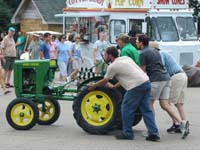 John Deere L tractor being pushed