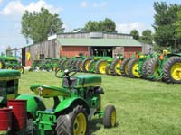 Featured John Deere tractors on exhibit.