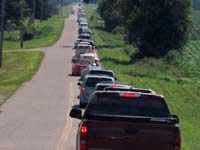 Long line of cars for the Little Log House show on Saturday