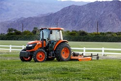 Kubota M7060 tractor with rotary cutter