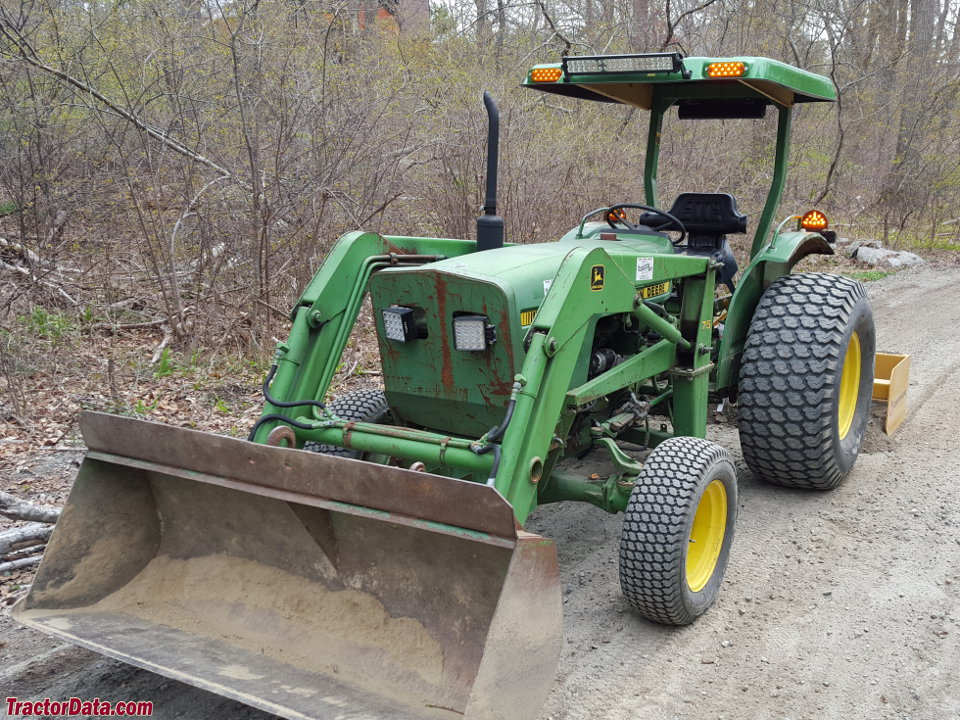 John Deere 1050 tractor with model 75 front-end loader.