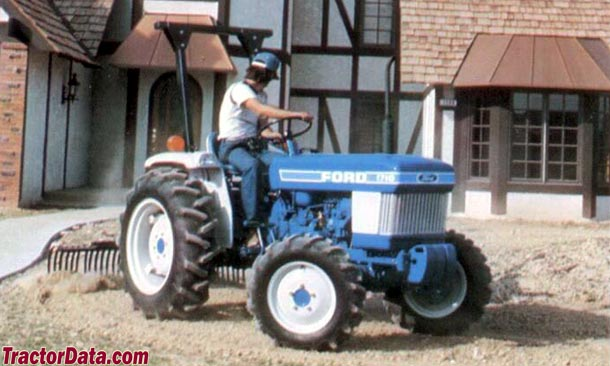 Ford 1710 with landscape rake.