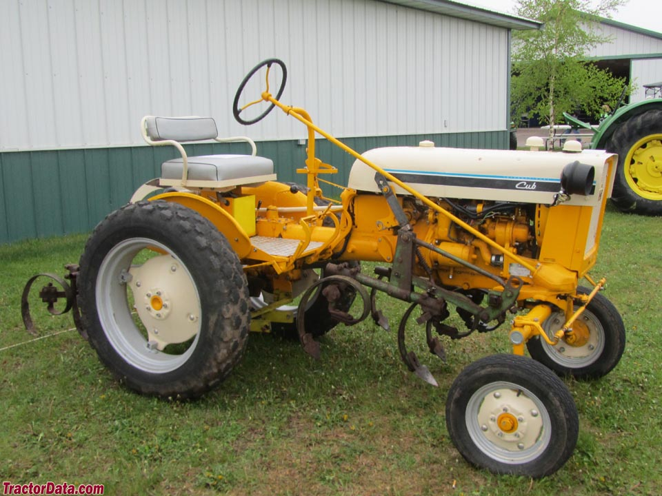 1965 yellow International Cub with mounted cultivators.
