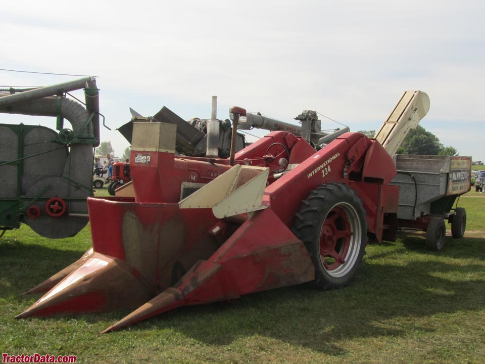 Farmall M with International 234 mounted corn picker with M & W Super Snoot.