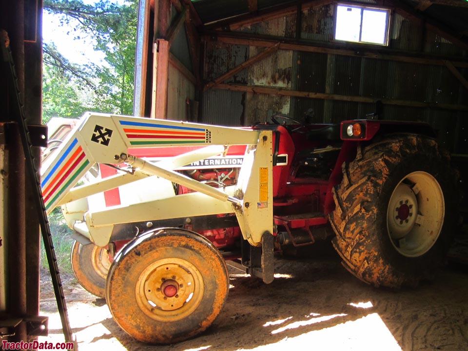 International 784 with front-end loader, left side.