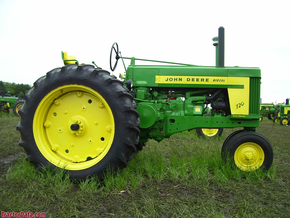 John Deere 720 diesel with Roll-a-matic tricycle front end.