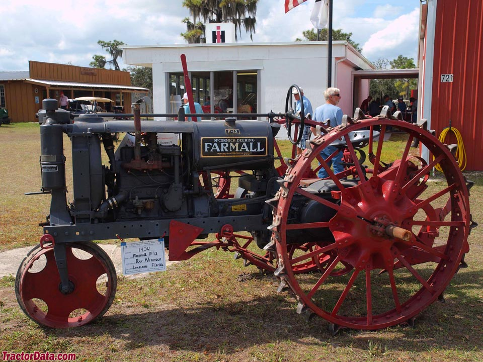 Gray Farmall F-12 on steel wheels.