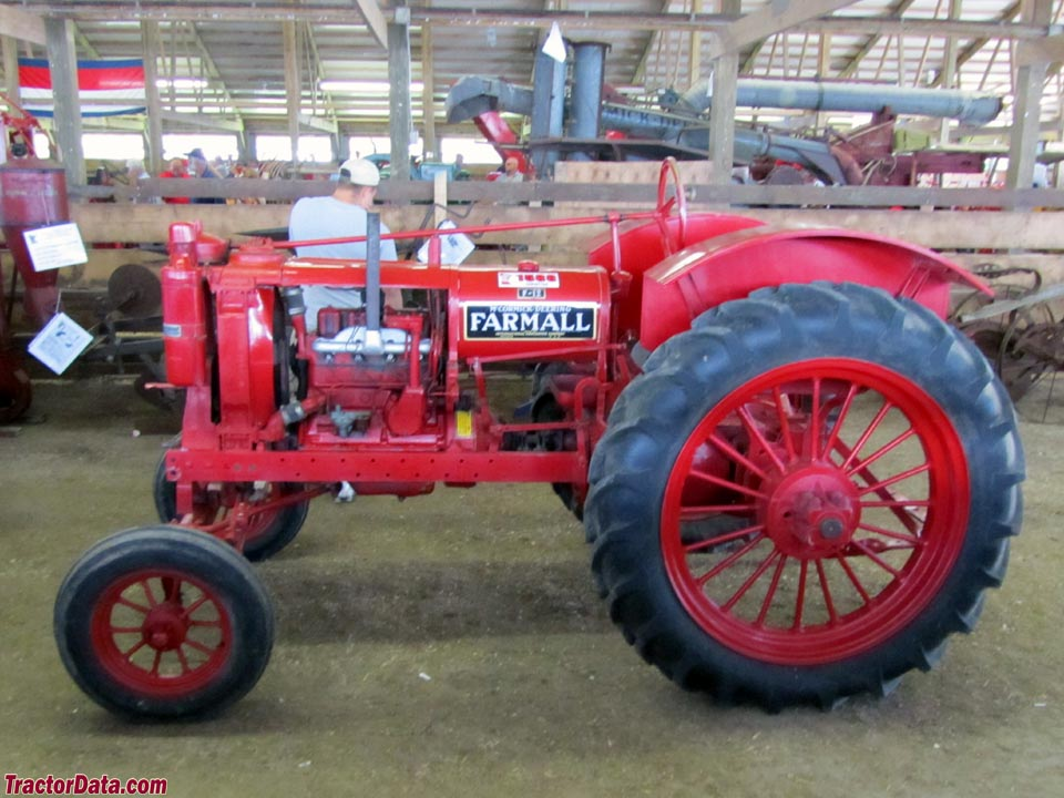 Red Farmall F-12 with wide front end.