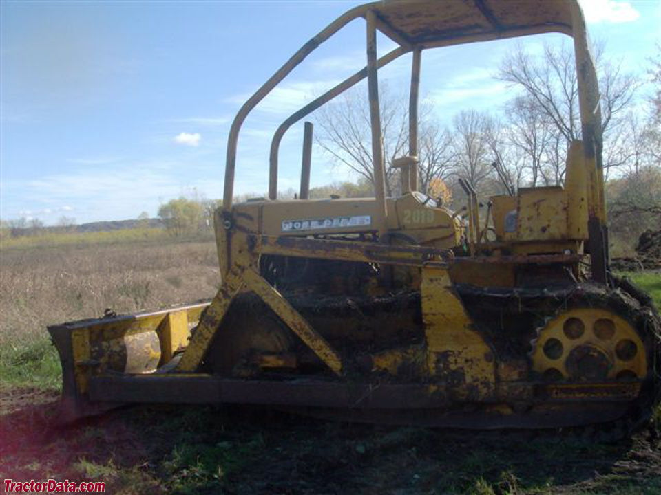 John Deere model 2010C crawler with dozer blade and ROPS.