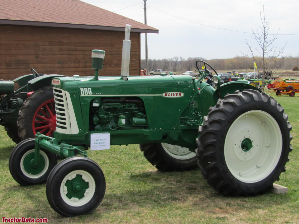 Row-crop Oliver 880 with diesel engine and wide front end.