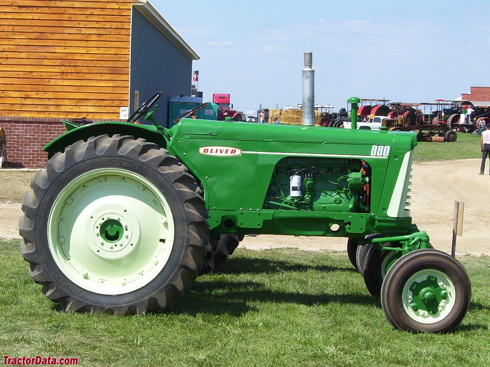Row-crop Oliver 880 with gasoline engine and wide front end.