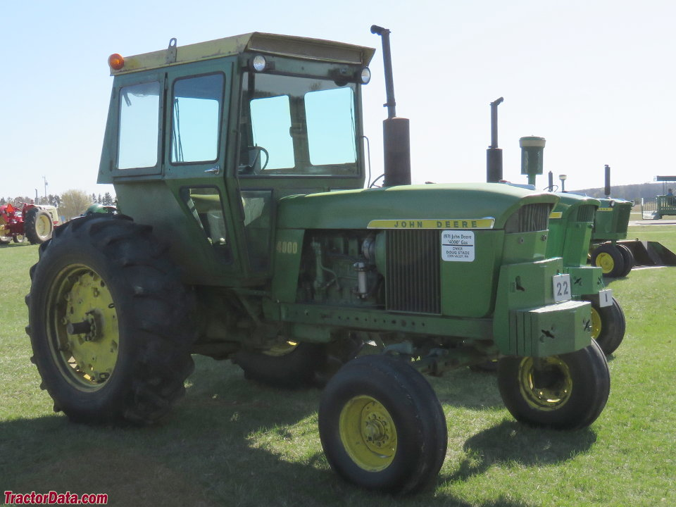 Gasoline John Deere 4000 with after-market cab.