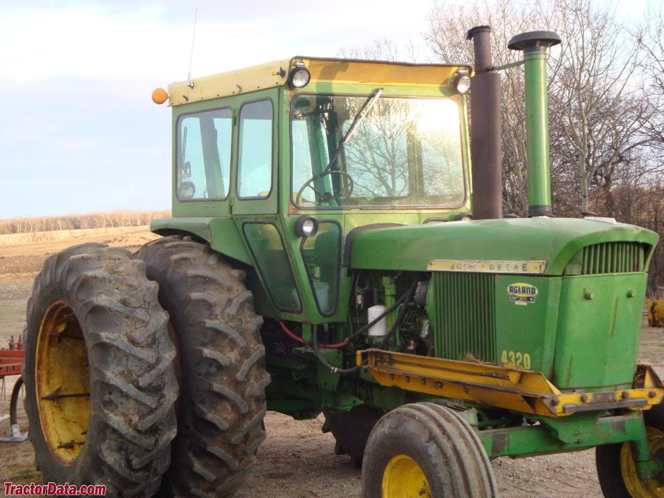 John Deere 4320 with after-market cab and dual wheels.
