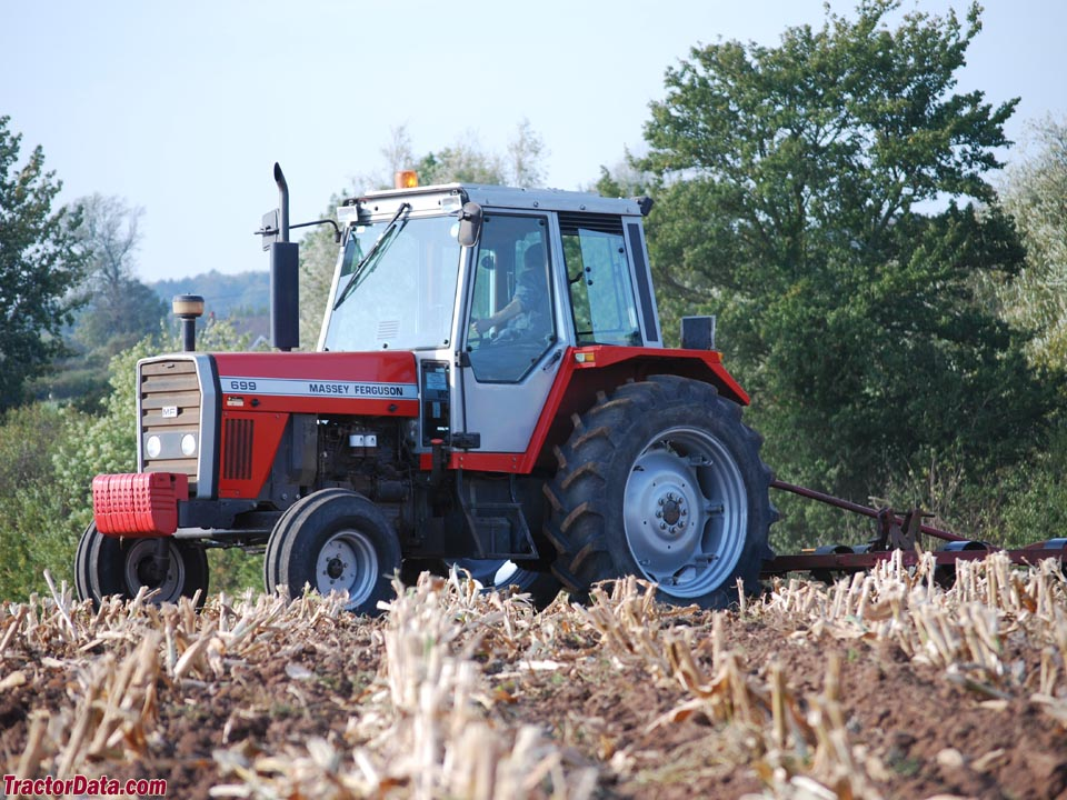 Massey Ferguson 699 performing spring field tillage, left side.