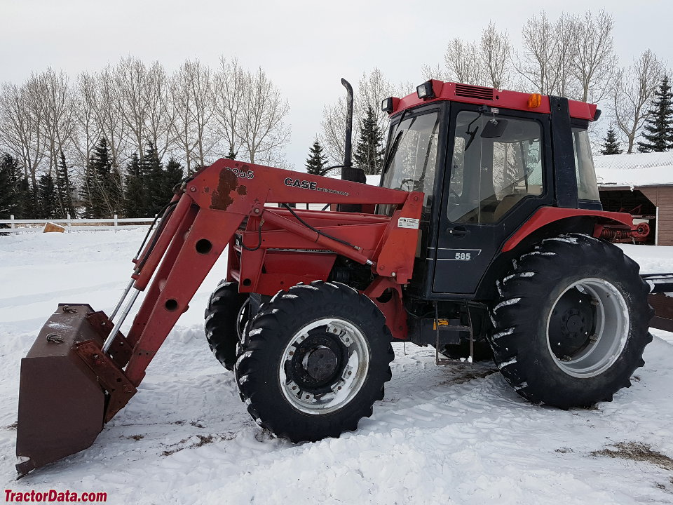 Four-wheel drive Case IH 585 with cab and loader.