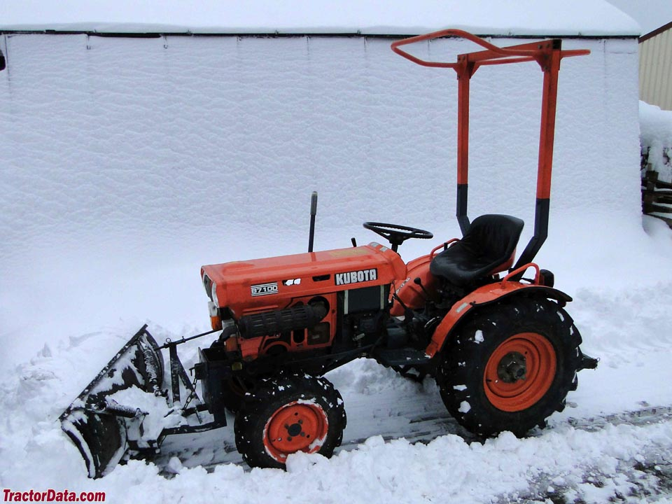 Kubota B7100D with front-mount blade.