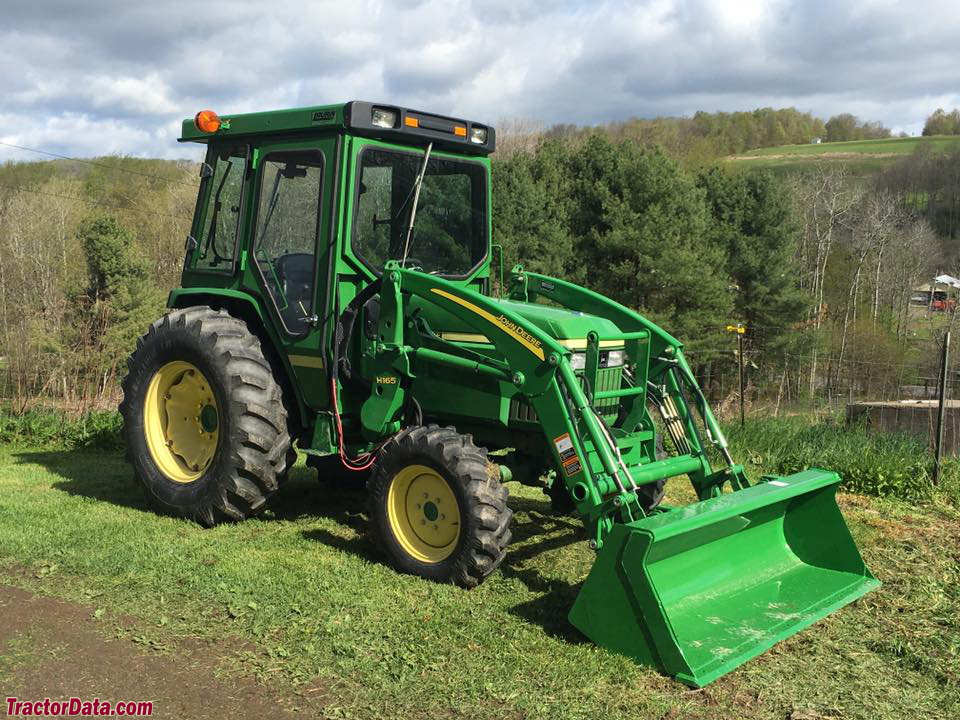 John Deere 990 with H165 front-end loader, right side.