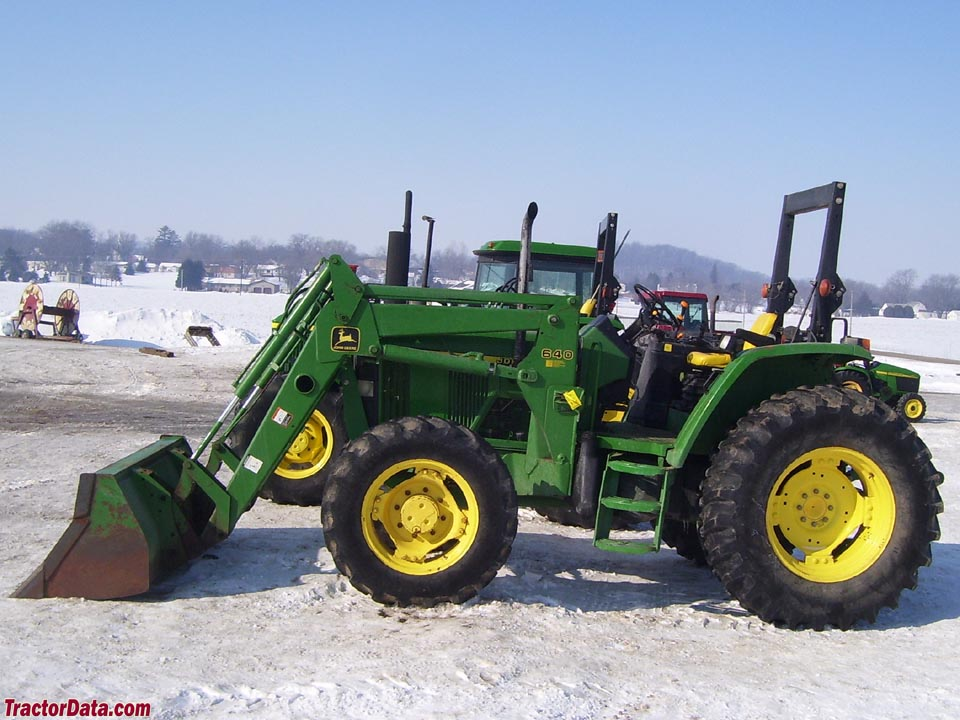 John Deere 6110 with ROPS and front-end loader.