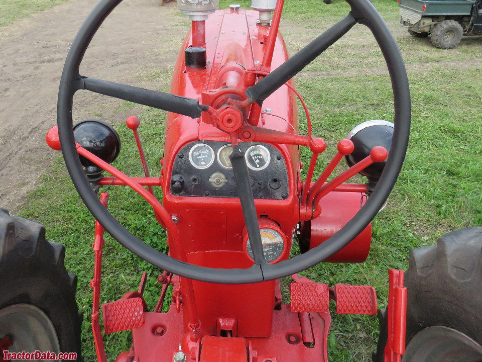 Farmall 450 operator station and controls.