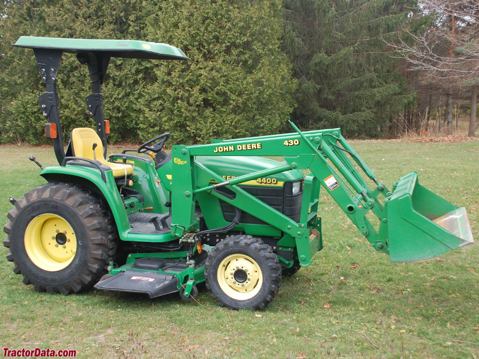 John Deere 4400 with 430 loader and mid-mount mower deck.