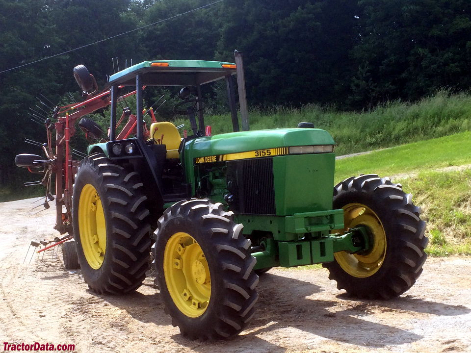 John Deere 3155 with four-post ROPS canopy, right side.