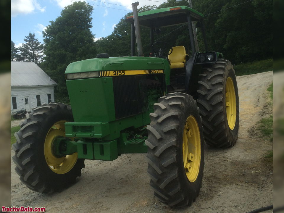 John Deere 3155 with four-post ROPS canopy, left side.