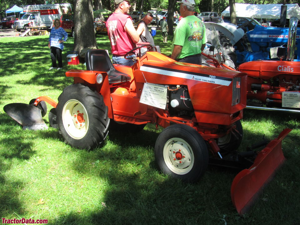 Allis-Chalmers 720 with plow and front blade.