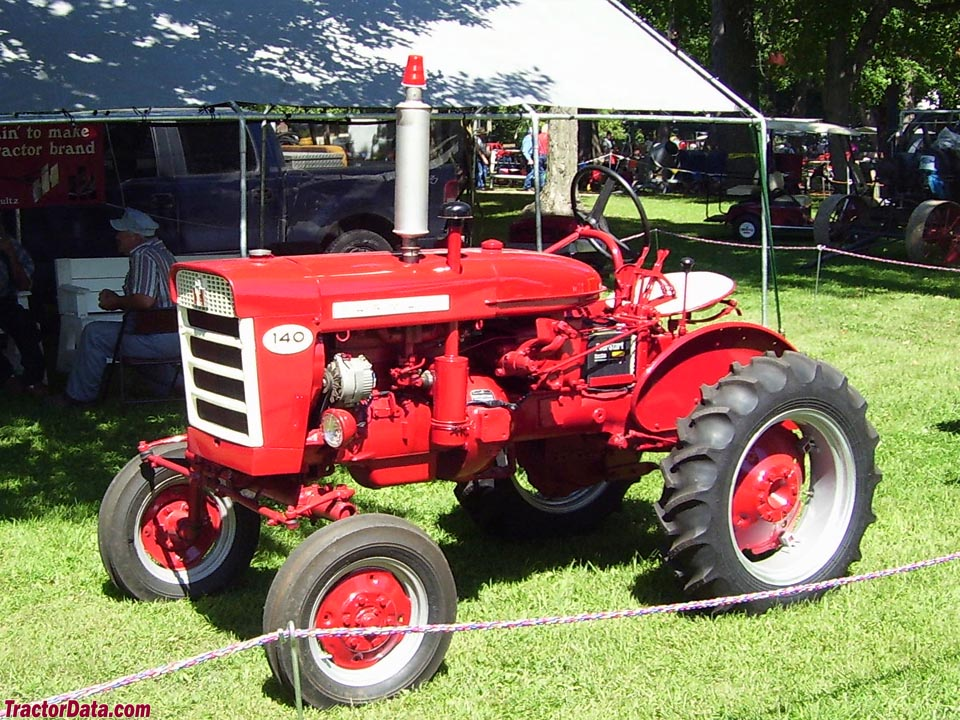 Early (pre-1963) Farmall 140 with white horizontal grill.