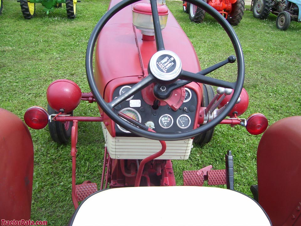 Farmall 560 operator station and controls.