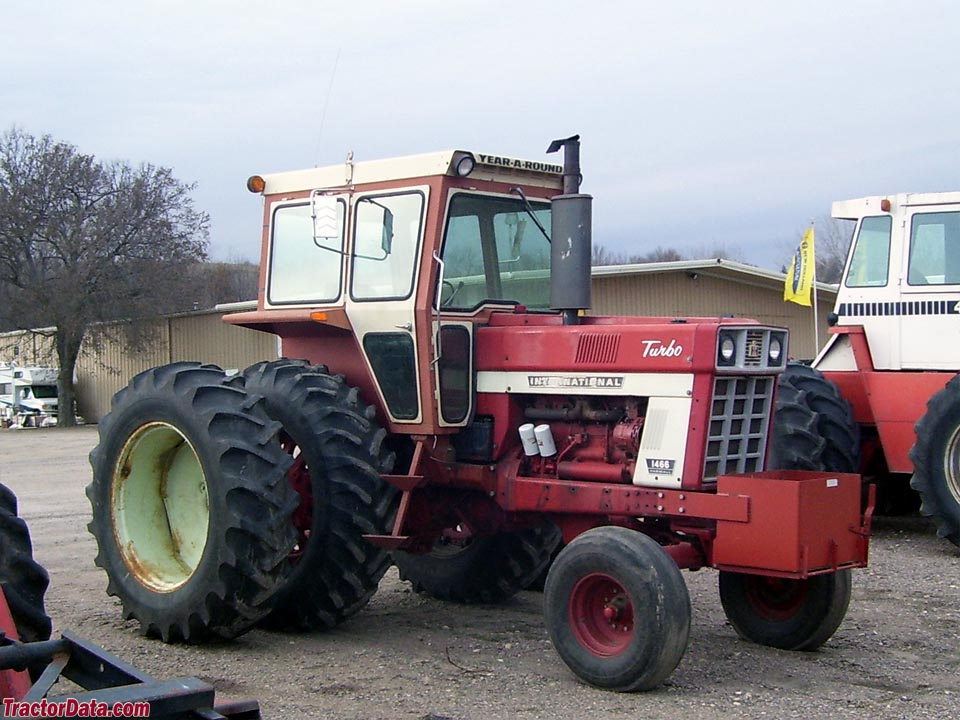 Farmall 1466 with after-market cab and duals.