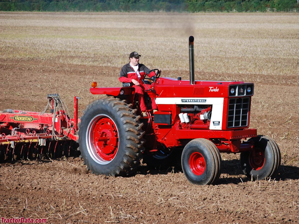 Open-station Farmall 1466 with Vaderstad disc.