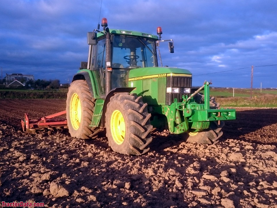 John Deere 6800 finishing a field.