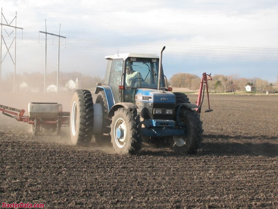 Ford 8340 with planter, front view.