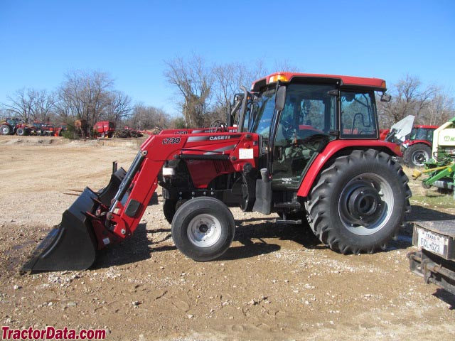 Case IH Farmall 95 with two-wheel drive, cab, and front-end loader.
