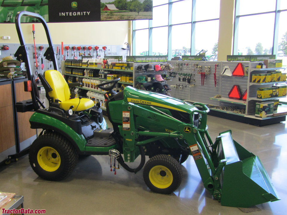 John Deere 1026R with loader.