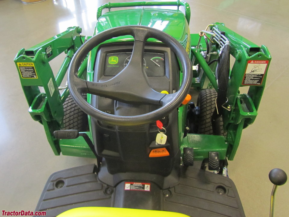 John Deere 1026R operator station and controls.
