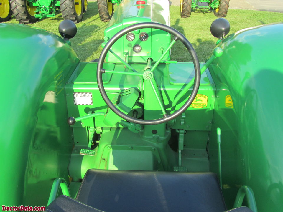 John Deere 60 Standard (low-seat) operator station and controls.