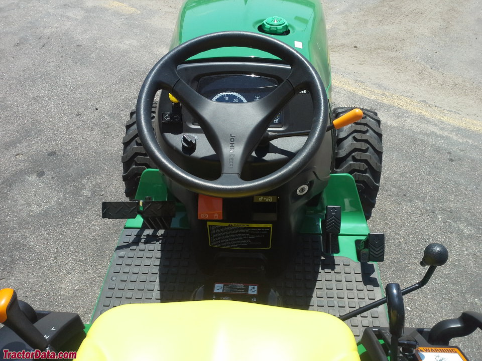 John Deere 2032R operator station and controls.