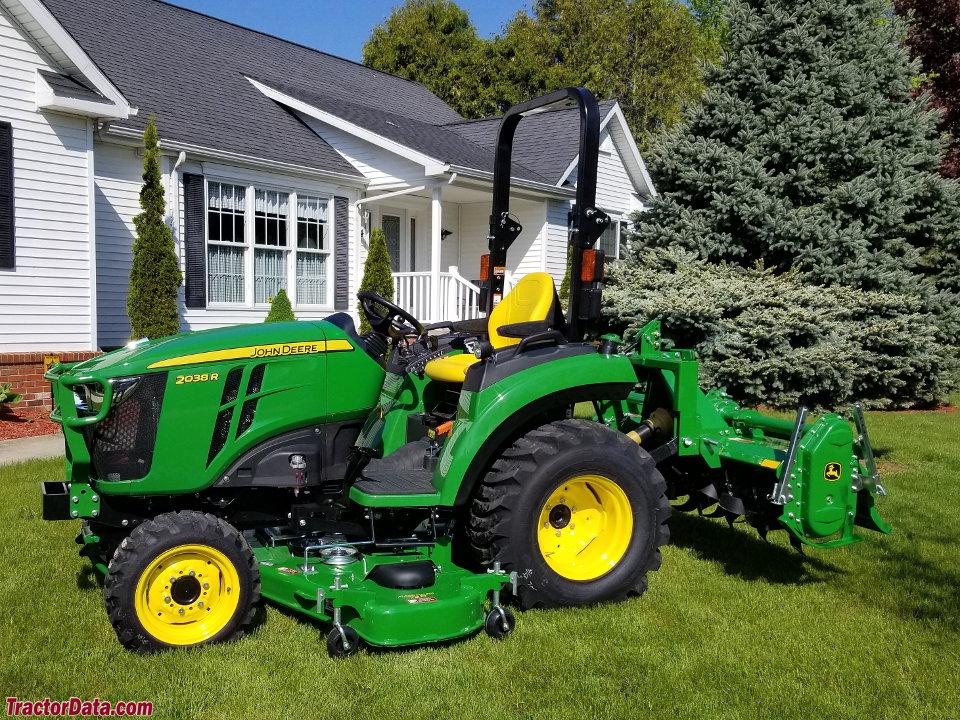 John Deere 2038R with mid-mount mower and tiller.