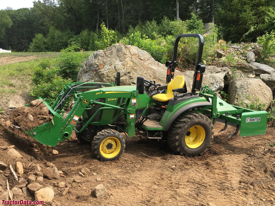 John Deere 2038R with loader and box blade, left side.