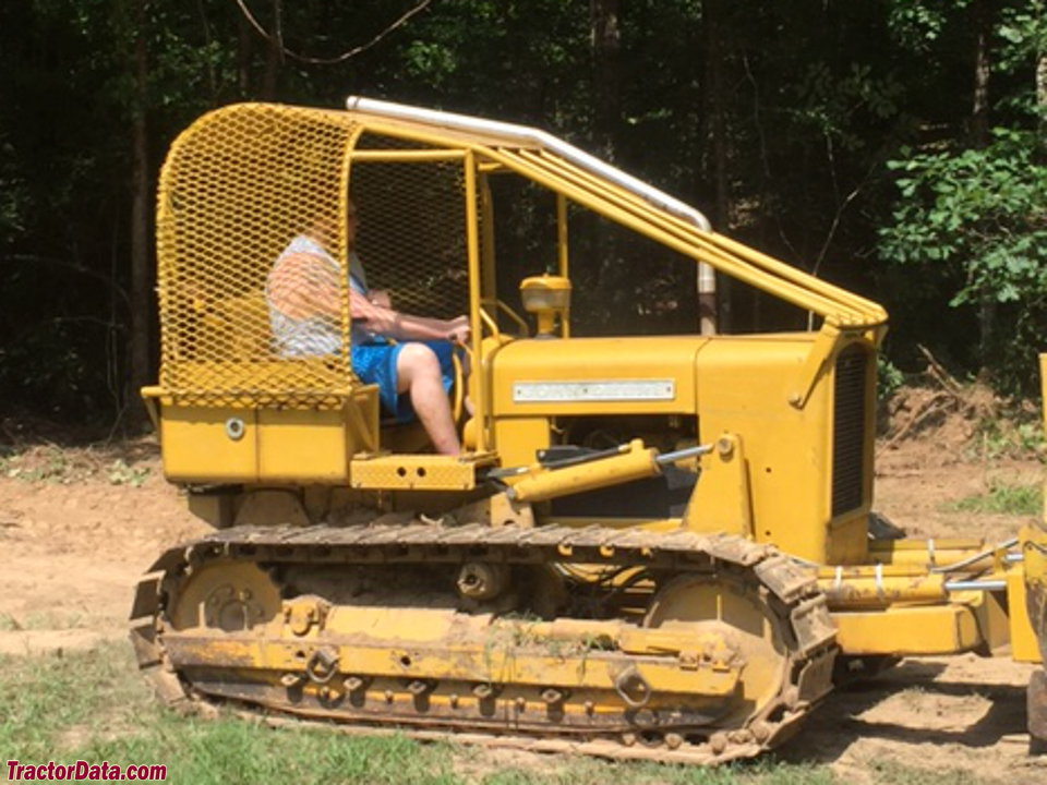 John Deere 350 with 6305 bulldozer and forestry enclosure.