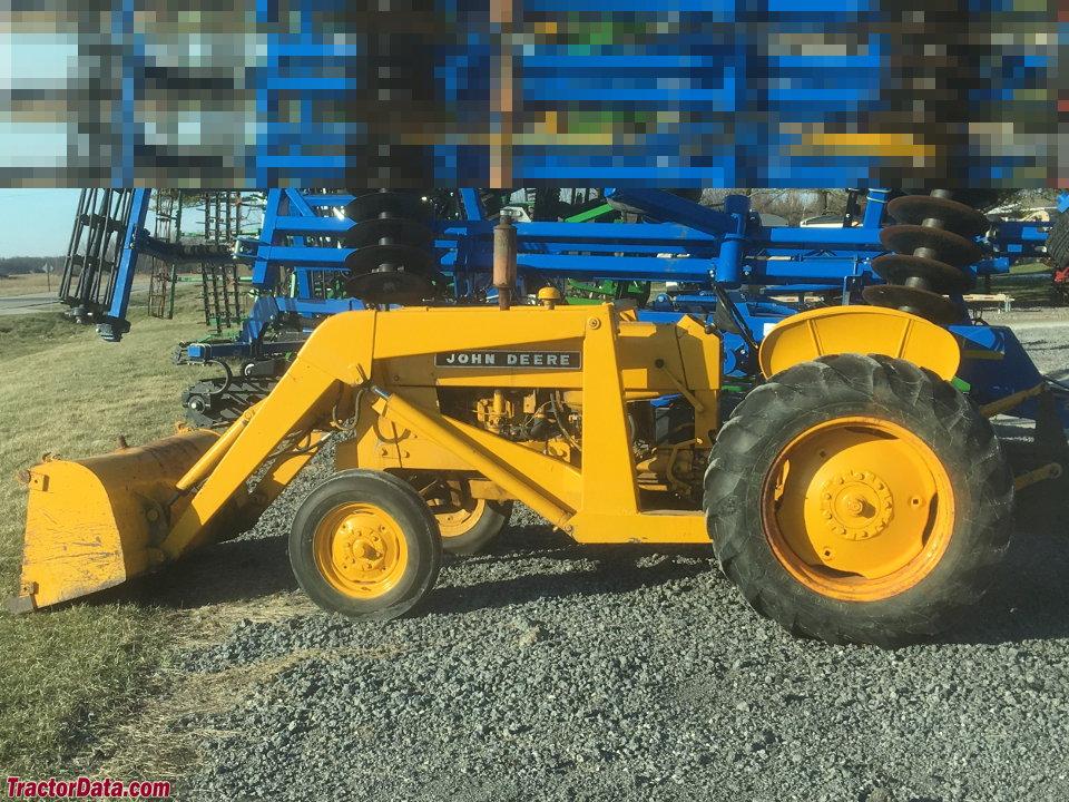 John Deere 440 with loader.